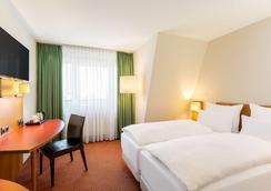 柏林城东部nh酒店 - 柏林 - 睡房