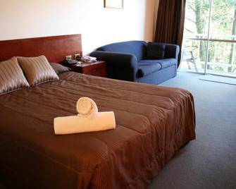 阿米蒂奇酒店 - 陶朗阿 - 睡房