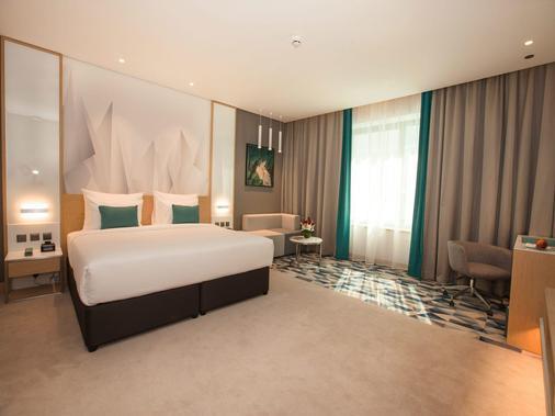 弗洛拉酒店 - 迪拜 - 睡房