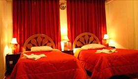 黄金屋旅馆 - 马丘比丘 - 睡房