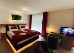 家寄宿式酒店 - 仅供成人入住 - 自助式入住与退房 - 康斯坦茨 - 睡房