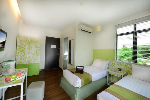康帕斯酒店集团兰卡威思庭酒店 - 兰卡威 - 睡房