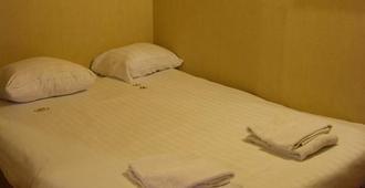 鲁汶大使套房酒店 - 鲁汶 - 睡房