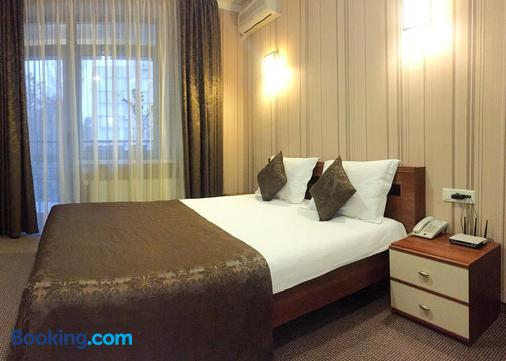 考米尔佛酒店 - 基希訥烏 - 睡房