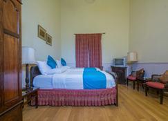 拉利莎马哈尔皇宫酒店 - 迈索尔 - 睡房