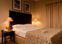 老天鹅酒店 - 哈罗盖特 - 睡房