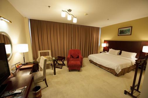 加雅中心酒店 - 亚庇 - 睡房