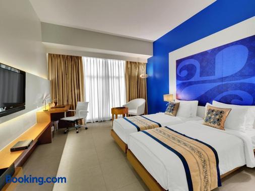 孟买费恩公寓酒店 - 孟买 - 睡房