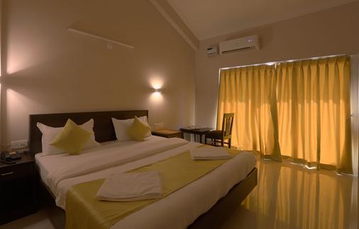 安朱纳海滨酒店 - 安朱纳 - 睡房