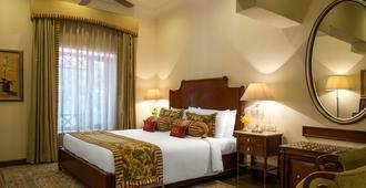 克拉里奇斯那霸居住酒店 - 慕苏里 - 睡房