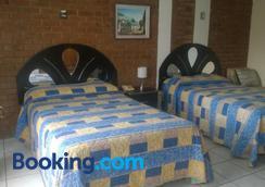 马里亚纳佩蒂特住宿加早餐旅馆 - 危地马拉 - 睡房