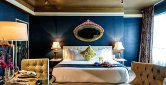 里维埃拉套房酒店 - 迈阿密海滩 - 睡房