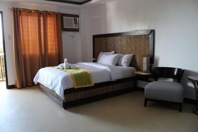 竹湾度假酒店及餐厅 - 长滩岛 - 睡房