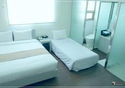 穆姆尔酒店 - 釜山 - 睡房