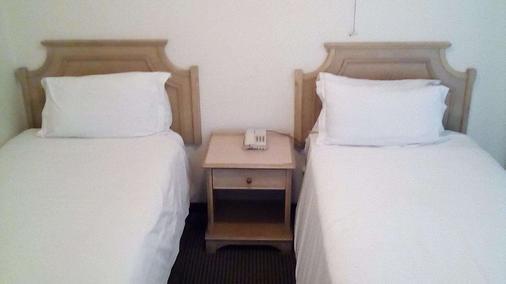 摄政普瑞米尔酒店 - 东伦敦 - 睡房