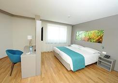 阿夸蒂斯酒店 - 洛桑 - 睡房