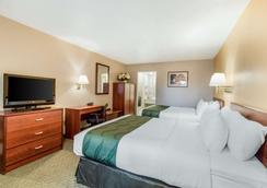 优质酒店 - 雪松城 - 睡房