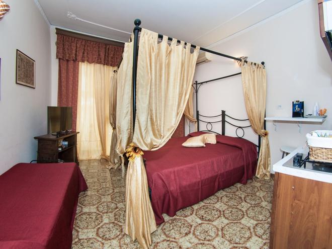 塔尔崇豪华住宿加早餐旅馆 - 塔尔奎尼亚 - 睡房