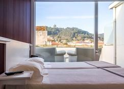 拉兰热拉酒店 - 维亚纳堡 - 睡房
