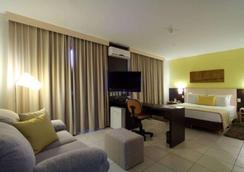 舒适戈亚尼亚酒店(克恩弗恩克奥斯中心) - 戈亚尼亚 - 睡房