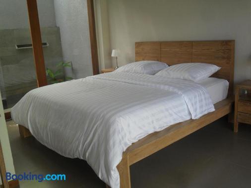 居布鲁酒店 - 新加拉惹 - 睡房