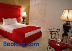扎尔洛斯莫奇斯酒店 - 洛斯莫奇斯 - 睡房