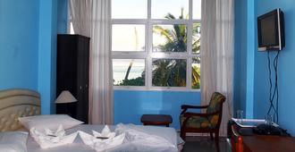 维泽特沙滩旅馆 - 马列 - 睡房