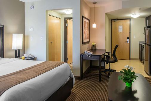 温尼伯曼斯戴套房酒店 - 温尼伯 - 睡房
