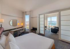 Nh拉斯佩齐亚酒店 - 斯培西亚 - 睡房
