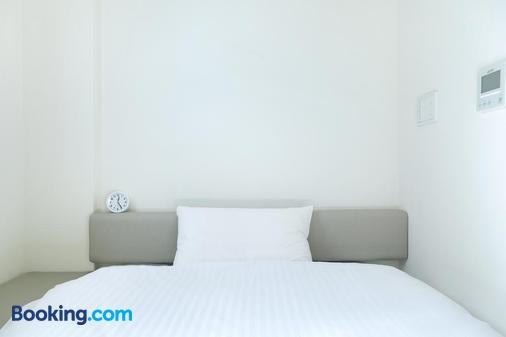 努卡酒店 - 带广市 - 睡房
