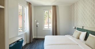 橄榄精品酒店 - 阿斯科纳 - 睡房