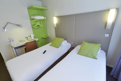 尚佩雷勒瓦卢瓦门巴黎西钟楼酒店 - 勒瓦卢瓦-佩雷 - 睡房