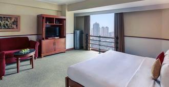 雅加达市美居雅加达太古酒店 - 西雅加达 - 睡房