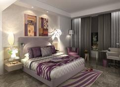 法里達巴德麗亭酒店 - 法里达巴德 - 睡房