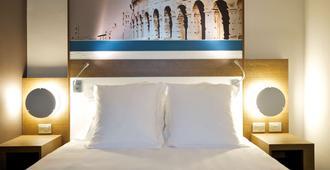罗马中心圆形竞技场美居酒店 - 罗马 - 睡房
