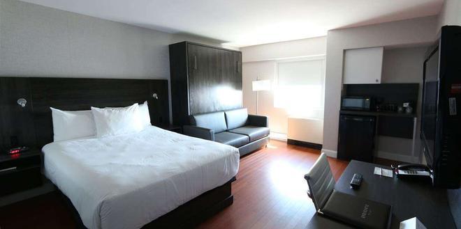 古典酒店 - 魁北克市 - 睡房