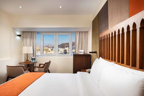 法拉吉酒店 - 马斯喀特 - 睡房