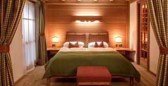 戴索尼诺小木屋酒店 - 麦当娜迪坎皮格里奥 - 睡房