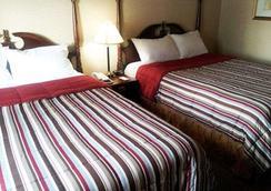 埃克诺城市中心旅馆 - 金斯顿 - 睡房