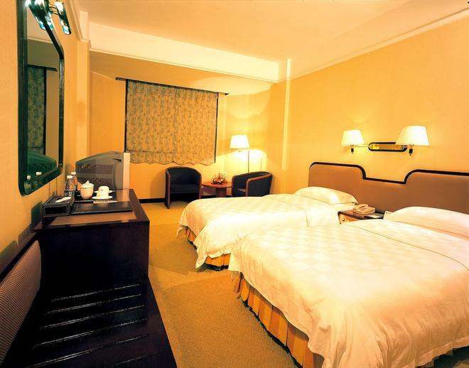 广州海涛酒店 - 广州 - 睡房