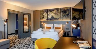 美居明斯特弗赖堡酒店 - 弗莱堡 - 睡房
