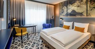 佛莱堡蒙斯特美居酒店 - 弗莱堡 - 睡房