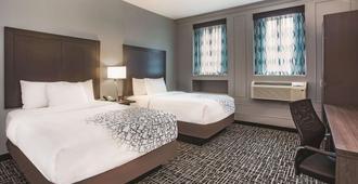 拉金塔巴尔的摩市中心旅馆及套房 - 巴尔的摩 - 睡房