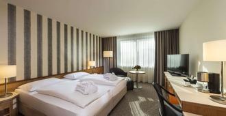 玛丽蒂姆斯图加特酒店 - 斯图加特 - 睡房