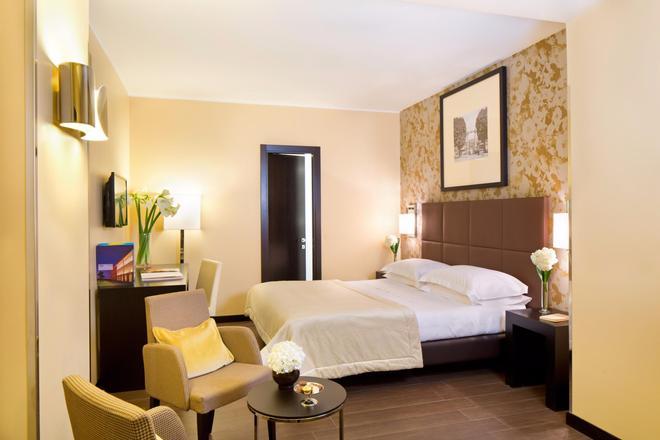 马捷斯特星级酒店 - 都灵 - 睡房