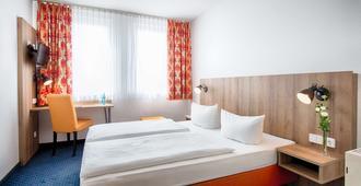 德累斯顿老城 Achat 酒店 - 德累斯顿 - 睡房