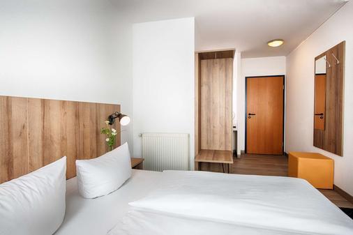 德累斯顿康福特阿莎特酒店 - 德累斯顿 - 睡房