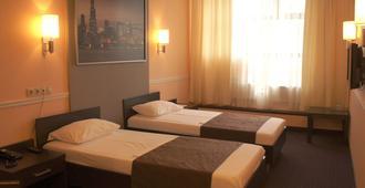 莫斯科尤金酒店 - 莫斯科 - 睡房