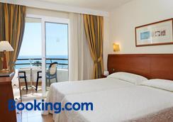 杜纳斯公寓式时尚酒店 - 卡拉米洛 - 睡房