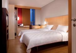 宜必思雅加达盛恩酒店 - 雅加达 - 睡房